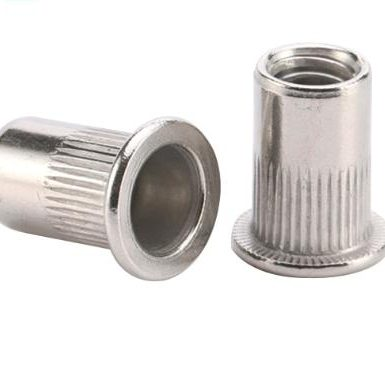 Rivet nut thread knurled body